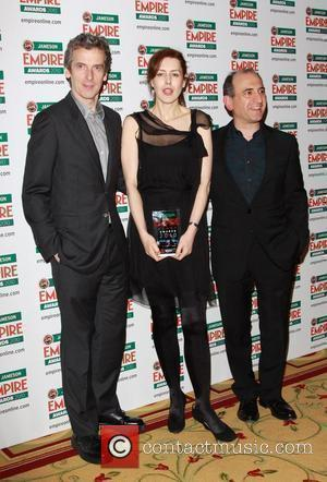 Ian Hislop, Peter Capaldi, Gina McKee and Director Armando Iannucci pose with the award for Best Comedy The Empire Film...