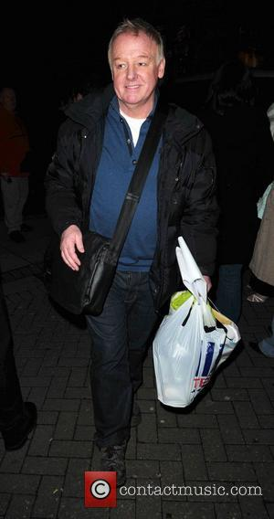 Les Dennis leaves the Liverpool Empire Theatre carrying a Tesco shopping bag after the final performance of the pantomime, Aladdin....