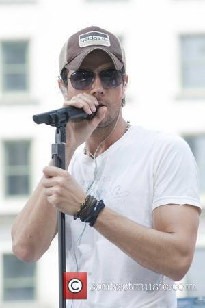Enrique Iglesias performing live on the 'CBS Early Show' at CBS Plaza New York City, USA - 16.07.10