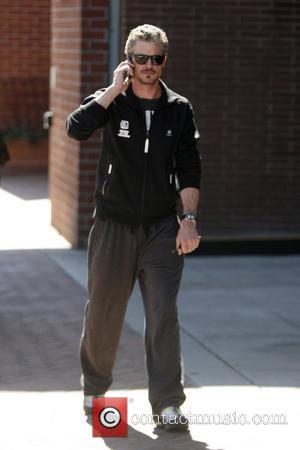 Eric Dane talking on his phone after leaving a medical building in Beverly Hills. Los Angeles, California - 24.09.10