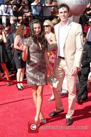 Noureen Dewulf and Ryan Miller