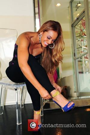 Reality TV personality Evelyn Lozada from VH1's 'Basketball Wives' shopping at Dulce shoe boutique. Coral Gables, Florida - 11.03.10