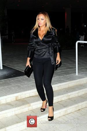 Evelyn Lozada of Vh1's 'Basketball Wives'  outside Mr. Chow restaurant. Miami Beach, Florida - 19.03.10