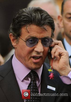 Slyvester Stallone Talks On His Mobile Phone