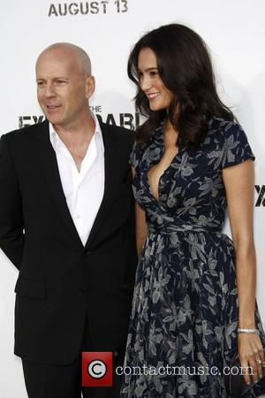 Bruce Willis and Emma Heming Los Angeles Premiere of 'The Expendables' held at Grauman's Chinese Theatre  Los Angeles, California...
