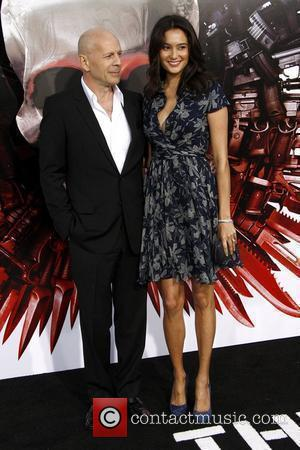 Bruce Willis and Emma Hemming Los Angeles Premiere of 'The Expendables' held at Grauman's Chinese Theatre  Los Angeles, California...