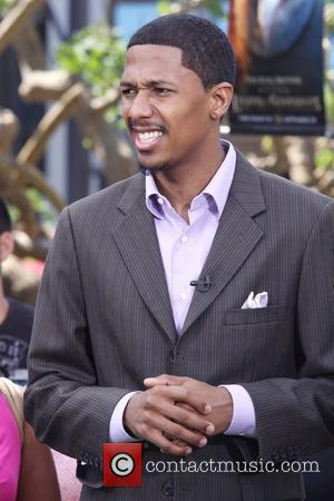 Nick Cannon filming a segment for 'Extra' at The Grove to promote his TV show 'America's Got Talent' Los Angeles,...