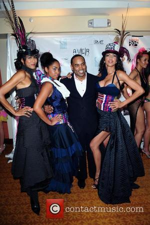 CBS 4 anchor Jawan Strader (C) and models Fashion Designers Expo Florida Fall 2010 at the Newport Beachside Resort...