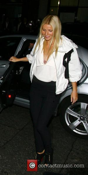 Gwyneth Paltrow showing part of a pink bra outside the Stella McCartney shop on Fashion's Night Out London, England -...