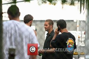 Fast And The Furious star Paul Walker near his trailer on set of 'Fast Five' in Hato Rey Hato Rey,...