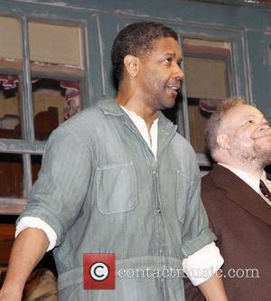 Denzel Washington on stage during the opening night curtain call for 'August Wilson's Fences' on Broadway at the Cort Theatre...