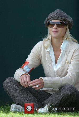 New Man? Elin Nordegren Sees Tiger's Millions, Raises Him $1.2 Billion