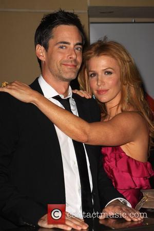 Poppy Montgomery and Her Husband Adam Kaufman