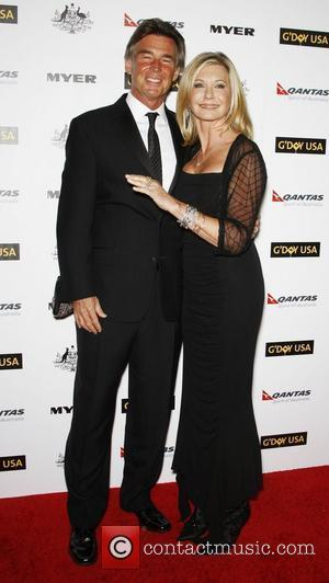 John Easterling and Olivia Newton John 2011 G'Day USA Los Angeles Black Tie Gala to honor Barry Gibb, Roy Emerson...