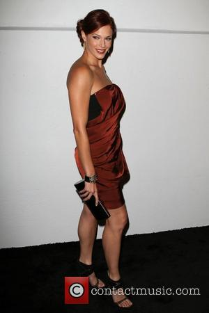 Amanda Righetti and Genesis