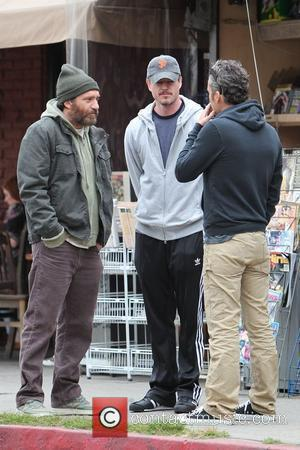 Eric Dane (C) dressed in casual sports wear and Balthazar Getty (R), talking to a friend outside the Kings Road...