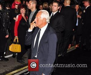 Giorgio Armani appears to be picking his nose, outside Fashion's Night Out event at the Armani store on Bond Street...