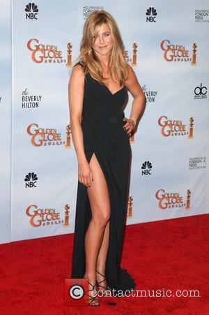 Aniston Creates Doll For Charity