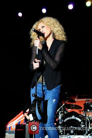 Kimberly Schlapman of Little Big Town performs at the Bud Light Orange Bowl Game Day Fan Zone during the 2011...