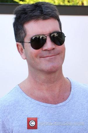 Cowell Backs Connick, Jr. As Idol Replacement
