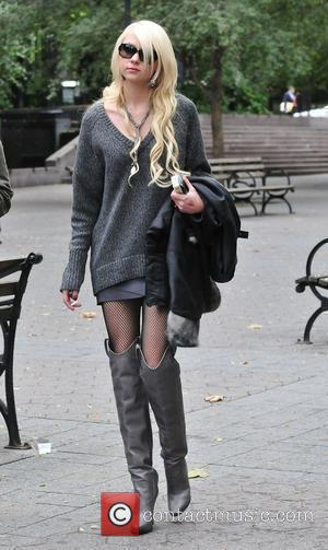 Taylor Momsen wearing a plaid jacket, oversized sweater, bandage dress, and over-the-knee boots on the set of Gossip Girl. New...