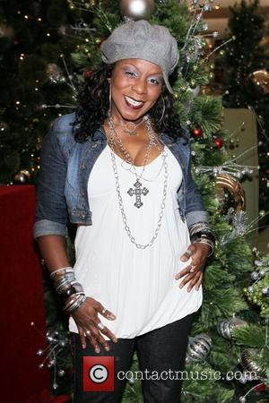 Grammy nominated recording artist, Grandma Funk, poses for pictures by the Christmas Tree in Westfield Culver City. Culver City, USA...