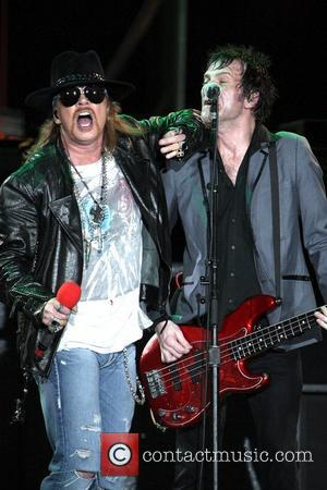 Guns 'N Roses perform live in concert at the ANZ Stadium as part of the Telstra 500 V8 motor racing...