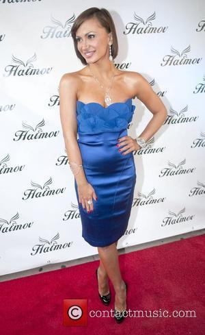 Karina Smirnoff from 'Dancing With The Stars' attends the grand re-opening of the Haimov Jewelers downtown Miami store during Superbowl...