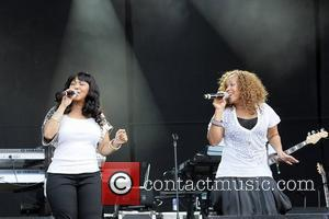 Erica Atkins-Campbell (L) and Tina Atkins-Campbell of Mary Mary perform at day 2 of Hard Rock Calling in Hyde Park...