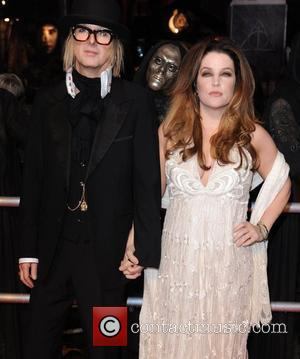 Lisa Marie Presley with her husband Michael Lockwood  World Premiere of 'Harry Potter and the Deathly Hallows Part 1'...