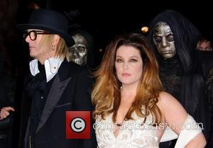 Michael Lockwood and Lisa Marie Presley  World Premiere of 'Harry Potter and the Deathly Hallows Part 1' held at...