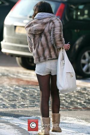 Helen Flanagan seen outside a studio wearing short denim shorts despite sub zero temperatures. Manchester, England - 04.01.10,