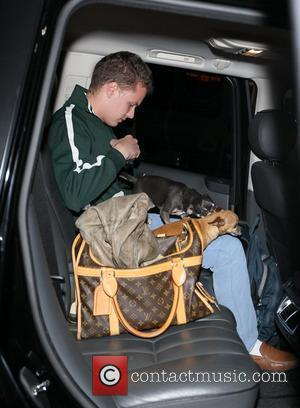 Barron Hilton and the family dogs arrive at LAX