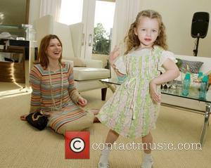 Milla Jovovich with daughter Ever Gabo The Hospitality Suite hosted by Pacal Mouawad held at the Nivea For Men's Mansion...