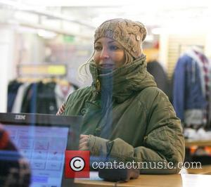 Natalie Appleton pays for an item at Urban Outfitters in London London, England - 01.12.10