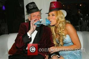 Hugh Hefner celebrates the New Year with his fiance Crystal Harris in a picture posted on Plixi.com USA - 31.12.10