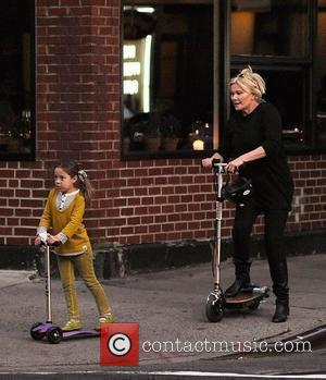 Deborra-Lee Furness and Hugh Jackman take a ride through the city with their children New York City, USA - 10.10.10