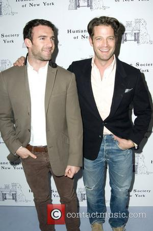 Nate Berkus and guest The Humane Society Of New York's Third Benefit Photography Auction at the Diane von Furstenberg Studio...