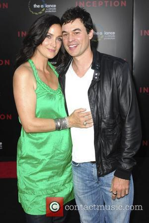 Carrie-Anne Moss and guest Warner Bros. Pictures' Los Angeles Premiere of Inception held at the Grauman's Chinese Theatre Hollywood, California...