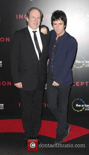 Hans Zimmer and guest Warner Bros. Pictures' Los Angeles Premiere of Inception held at the Grauman's Chinese Theatre Hollywood, California...