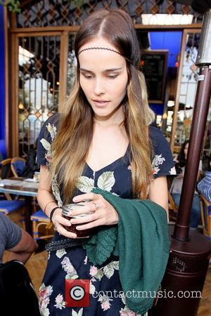 Isabel Lucas wearing a headband as she leaves Little Next Door restaurant after having lunch with friends Los Angeles, California...