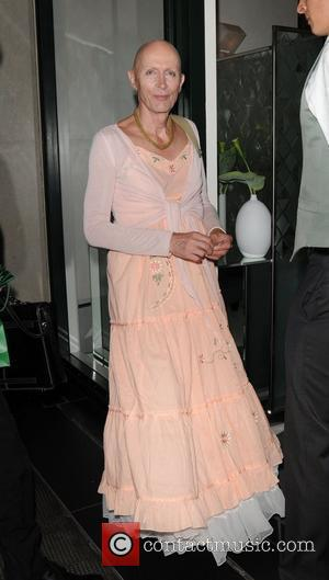Richard O'Brien in a long peach floral dress leaves the Ivy club London, England - 30.06.10
