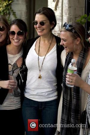 Sela Ward poses for pictures with fans as she leaves The Ivy on Robertson Boulevard Los Angeles, California - 08.01.10