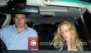 Gillian Anderson and her husband Mark Griffiths seen leaving The Ivy Club in London's West End