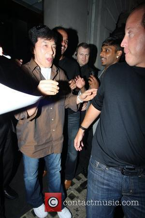 Jackie Chan leaving Nobu restaurant where he was mobbed by adoring female fans London, England - 18.07.10