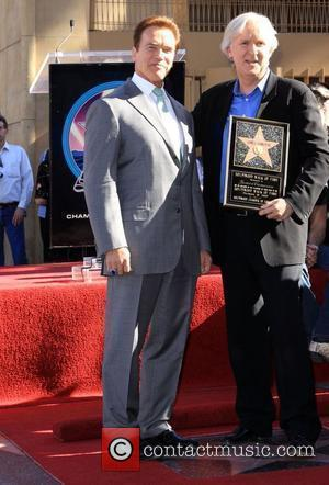 James Cameron and Arnold Schwarzenegger James Cameron honoured with the 2,396th star on the Hollywood Walk of Fame Los Angeles,...