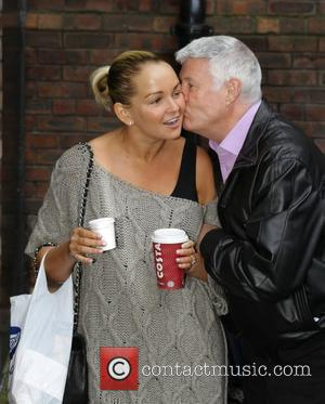 Jennifer Ellison gets a kiss from a fan Jennifer Ellison arriving at the the Liverpool Empire Theatre for the opening...