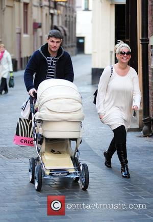 Jennifer Ellison and husband Robbie Tickle  with newly born baby boy Bobby out shopping in the City Centre...