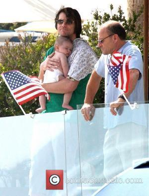 Jim Carrey holding his grandson Jackson Santana on Malibu Beach Malibu, California - 04.07.10