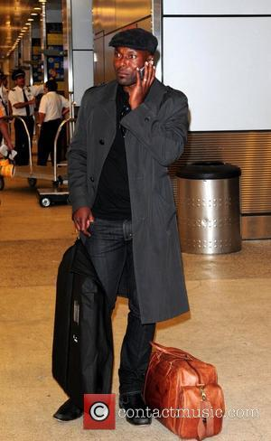 Jimmy Jean Louis star of the NBC Television series 'Heroes' seen arriving at Miami International airport carry a Puma overnight...